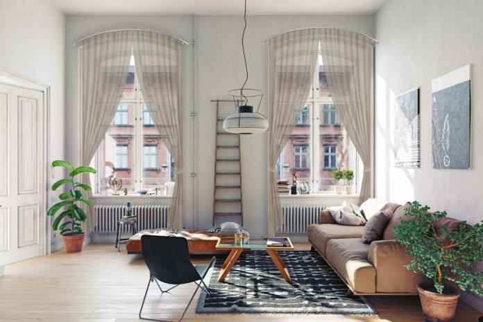 Gięte karnisze użyte do dekoracji okna o nieszablonowym kształcie.