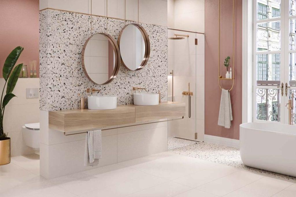 Wanna i prysznic w łazience. Aranżacja z wykorzystaniem ceramicznych płytek ze wzorem lastryko z kolekcji Hika firmy Cersanit