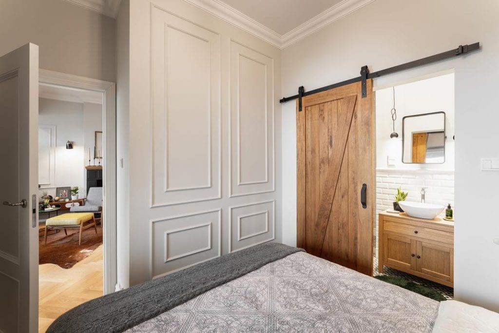 Przesuwane drzwi do łazienki wykonane ze szczotkowanego drewna.