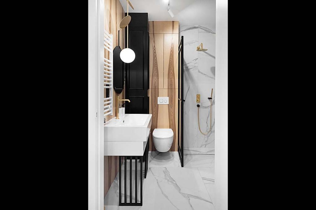w łazience miesza się styl industrialny z butikową elegancją