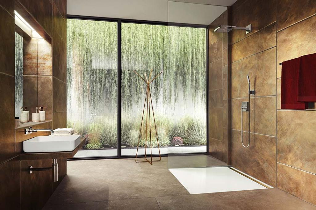 Łazienka zpowierzchnią prysznicową, wykonaną zestali emaliowanej Kaldewei