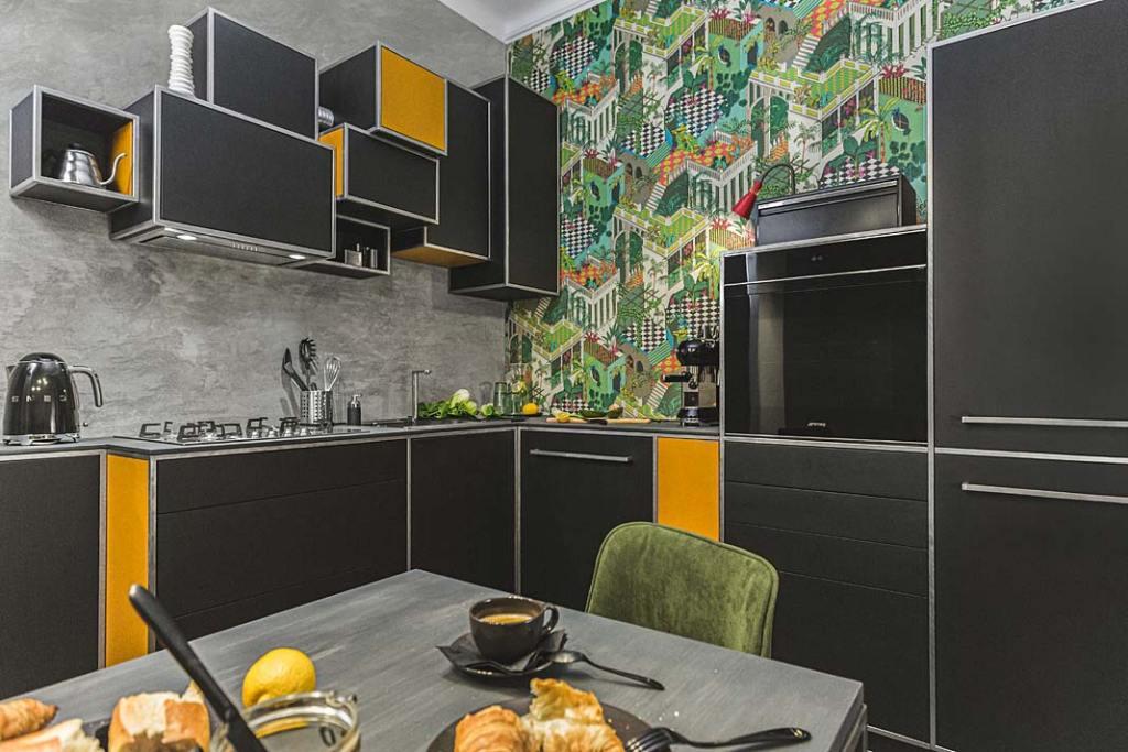 Czarny kolor w kuchni: meble kuchenne zaprojektowane przez Tomasza Pągowskiego