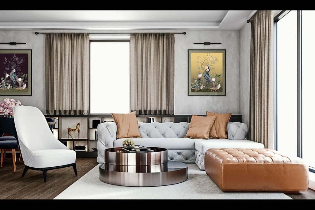 Pikowane sofy i eleganckie obrazy są mile widziane we wnętrzu w stylu preppy. Fot. RuckZuck