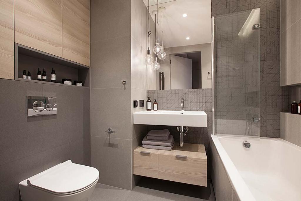 Nowoczesne mieszkanie dla rodziny:  łazienka. Projekt: Natalia Jargiełło