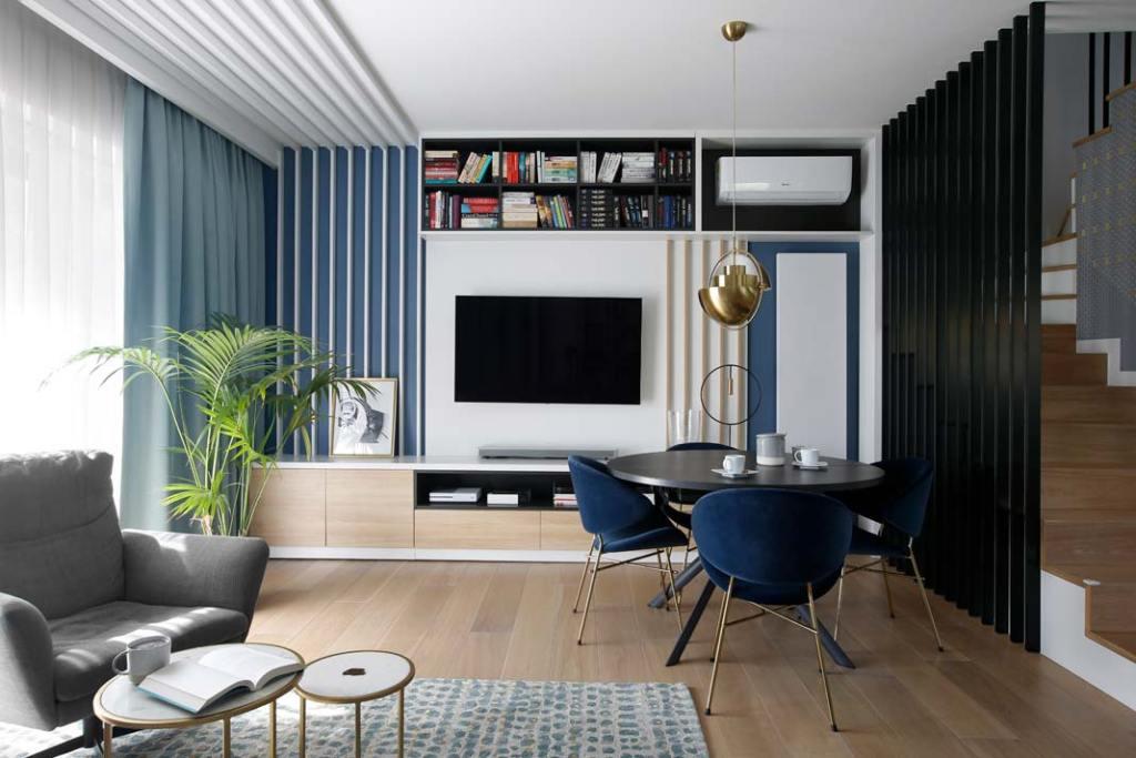 Nowoczesne mieszkanie dla rodziny. Salon z kącikiem jadalnianym. Projekt: MIKOŁAJSKAstudio