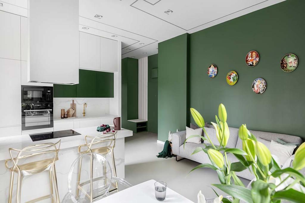 Butelkowa zieleń w salonie połączonym z kuchnią. Projekt Magdalena Bigos-Smoszna, Idea by Mag
