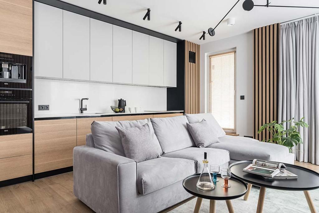 Nowoczesny apartament - otwarta kuchnia połączona z salonem. Projekt Studio Projekt