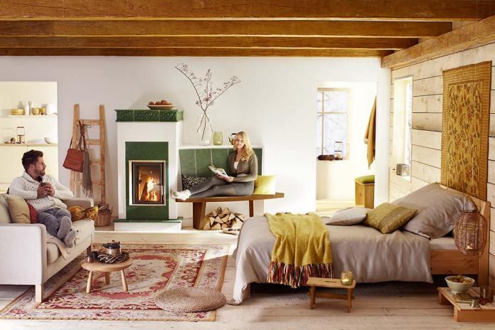 Przytulny dom, aranżacja z piecem kaflowym z wkładem Brunner
