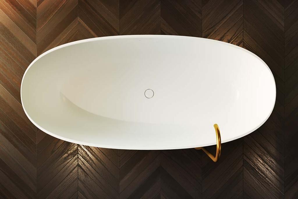Złote dodatki do łazienki, wanna Oval Solid Surface Riho