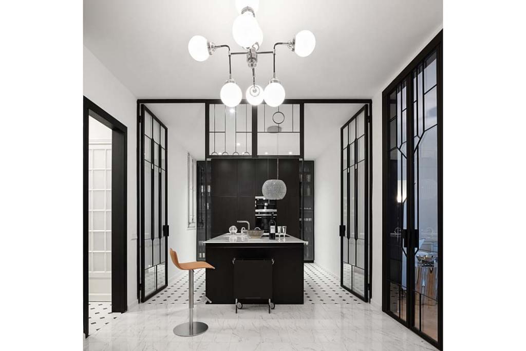Apartament w Barcelonie, do kuchni prowadzą olbrzymie witrażowe drzwi. Projekt Valgreen Studio