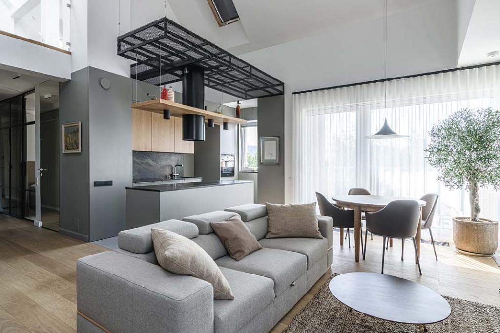 Kuchnia z wyspą połączona z salonem i jadalnią. Projekt Plan 9 Studio Architektury