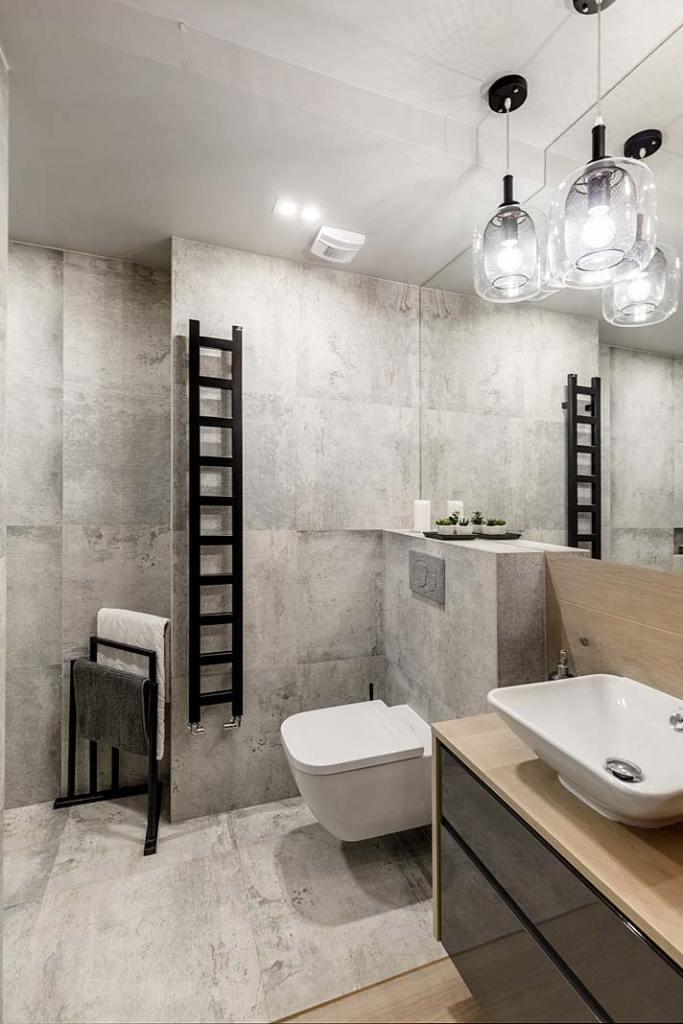 Beton na ścianie w łazience. Projekt Monika Staniec