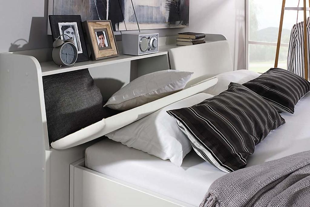 Łóżko Reinheim z miejscem do przechowywania w zagłówku